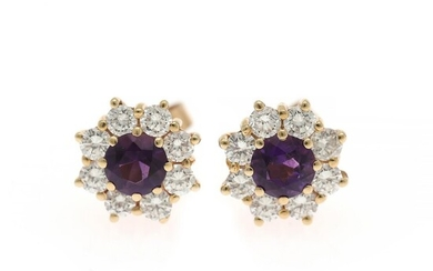 Ruben Svart: A pair of amethyst and diamond ear studs each set with a circular-cut amrethyst encircled by numerous brilliant-cut diamonds, mounted in 14k gold.
