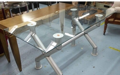 TABLE, Industrial style, the glass top on tubular metal supp...