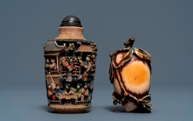 Two Chinese polychrome ivory snuff bottles, 19th C....