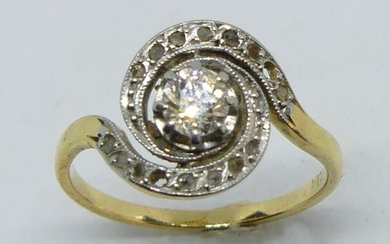 Two-gold tourbillon ring, set with a central diamond, surrounded by roses (some missing). Gross weight 3.1 g