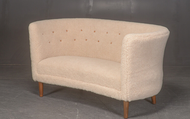 Two-seater sofa, the middle of the 1900th century, upholstered in lamb wool.
