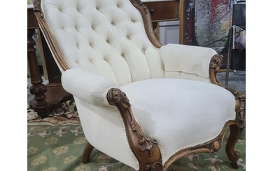 Victorian mahogany framed chair in a cream brown button back...