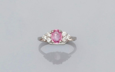 White gold ring, 750 MM, set with an oval pink sapphire weighing 0.86 carat between six brilliants, size: 53, weight: 2.5gr. gross.