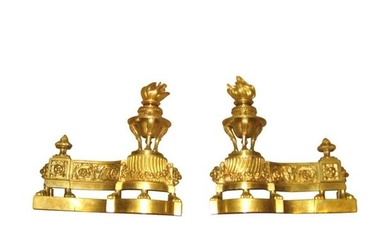 1 Pair of chased gilt bronze andirons. Currently...