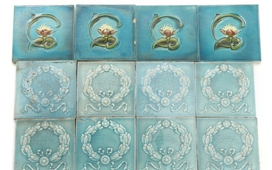 12 faience tiles, decorated with water lilies and garlands. England. Circa 1900. 15.5×15.5 and 14.5×14.5. (12)