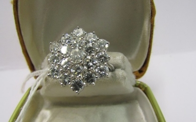 18CT WHITE GOLD DIAMOND CLUSTER RING, 19 brilliant cut well ...