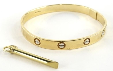 A 9ct gold bangle, with etched design, makers stamp...