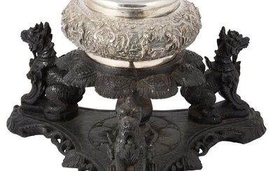 A BURMESE SILVER BOWL AND COVER ON WOOD STAND,...