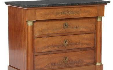 A Charles X mahogany chest of drawers with black Belgian granite top. Ca. 1830. H. 88 cm. W. 103 cm. D. 52 cm.