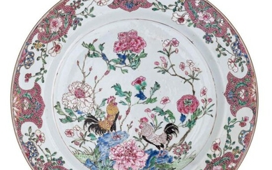 A Chinese famille rose export porcelain plate, decorated with cockerels in a flower garden, ø 35,5 cm