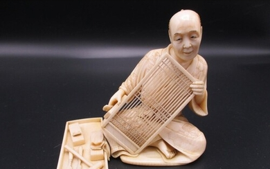 A Japanese Meiji period ivory okimono, modelled as an artisa...