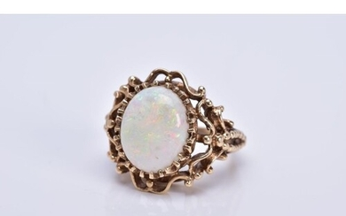 A LATE 20TH CENTURY 9CT GOLD OPAL SINGLE STONE RING, opal me...