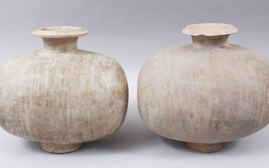 A PAIR OF UNUSUAL EARLY CHINESE BARREL SHAPED