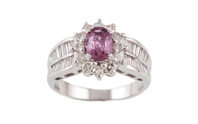 A PINK SAPPHIRE AND DIAMOND OVAL CLUSTER RING, one oval cut ...