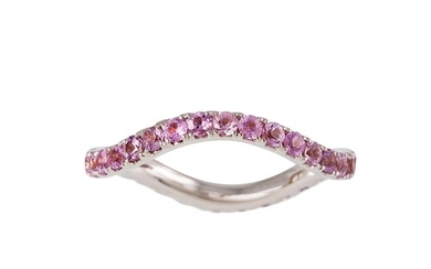 A PINK SAPPHIRE ETERNITY RING, wavy design, set with circula...
