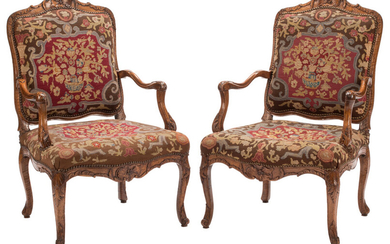 A Pair of Regence-Style Walnut and Needlepoint Upholstered Armchairs (18th century)