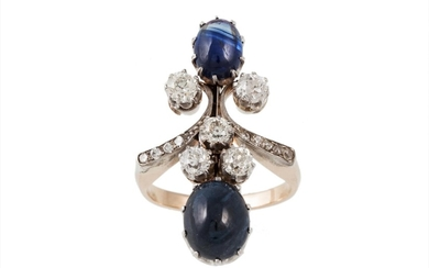 A SAPPHIRE AND DIAMOND FINGERLINE RING, set with two cabacho...