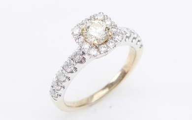 A YELLOW DIAMOND AND DIAMOND RING-The fancy yellow round brilliant cut diamond weighing 0.55cts, surrounded & shouldered by round br...