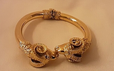 A bracelet of gold plated sterling silver decorated with ram heads. Diam. app. 7 cm. Weight app. 42 g.