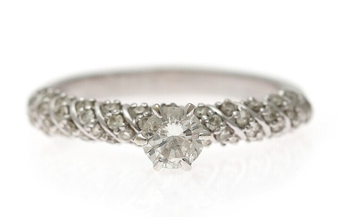 A diamond ring set with a brilliant-cut diamond weighing app. 0.40 ct. and brilliant-cut diamonds...