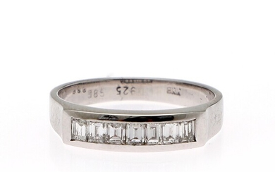 A diamond ring set with numerous baguette-cut diamonds, mounted in 14k white gold. W. 4 mm. Size 51.5.