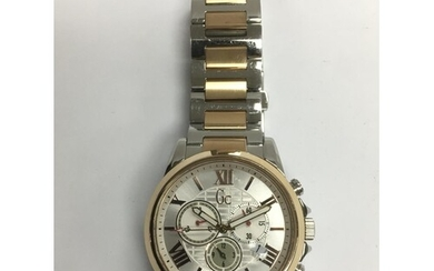 A gents Guess stainless steel watch.