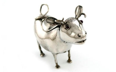 A late 19th century Continental silver cow creamer,...