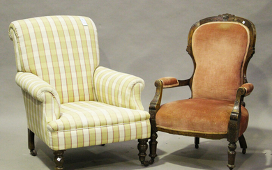 A late 19th/early 20th century scroll back armchair, on turned beech legs and castors, height 90cm