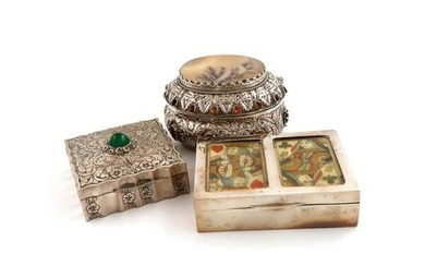 A mixed lot of silver boxes, comprising: one with an Austrian import mark, oval form, the hinged cover set with a hardstone panel, embossed decoration, and applied with coloured cabochons, length 10.5cm, an Edwardian playing cards box, by H V Pithey &...