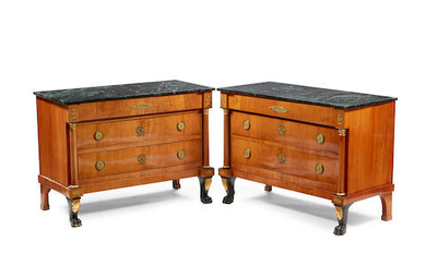 A pair of Baltic Neoclassical marble top gilt metal mounted part ebonized commodes