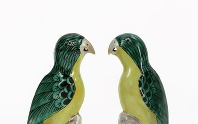 A pair of Chinese Export porecelain figures of parrots