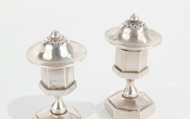 A pair of Chinese silver salt and pepper shakers