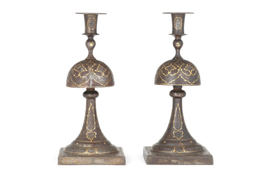 A pair of Qajar gold damascened steel candlesticks