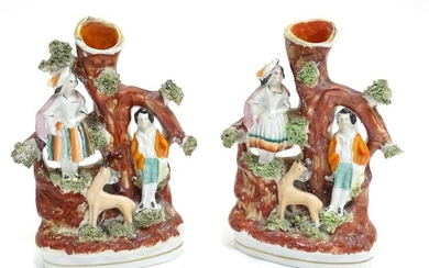A pair of Staffordshire figural spill vases with a man