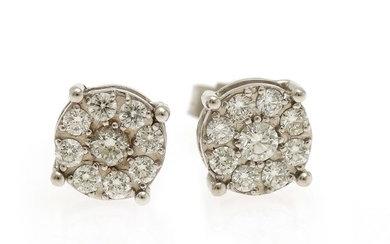 A pair of diamond ear studs each set with nine brilliant-cut diamonds totalling app. 0.64 ct., mounted in 18k white gold. Diam. app. 8 mm. (2)