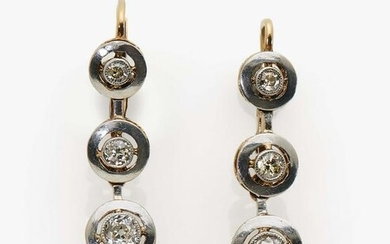 A pair of earrings with diamonds