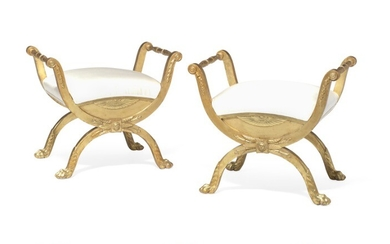 A pair of late Gustavian giltwood stools each with X-shaped legs and animal paws joined by profiled stretcher. Stockholm, late 18th century. (2)