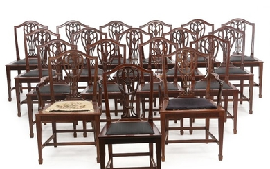 A set of 18 English mahogany dining chairs, heeof a pair of armchairs. Early 20th century. (18).