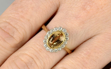 A yellow topaz and diamond cluster ring.