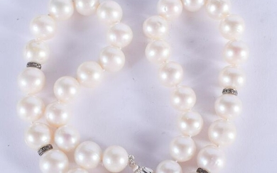 AN 18CT GOLD DIAMOND AND PEARL BROOCH. 40 cm long.