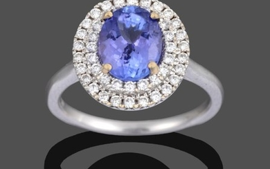 An 18 Carat Gold Tanzanite and Diamond Cluster Ring, the...