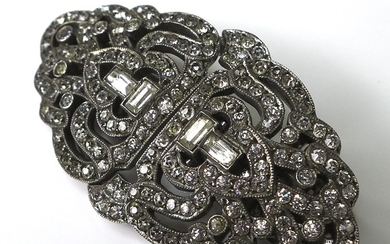 An Art Deco metamorphic brooch, white metal and set with pas...