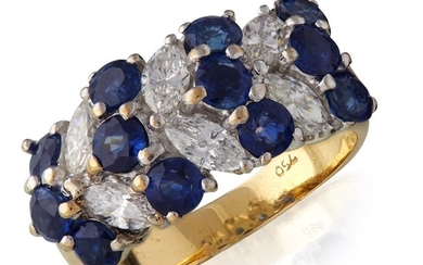 An eighteen karat gold, sapphire, and diamond ring comprised...