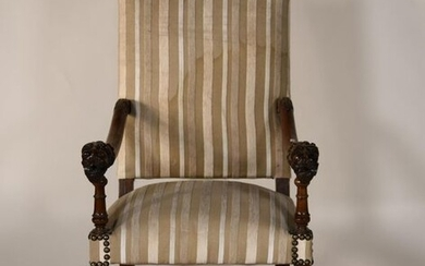 *Armchair in turned wood, carved lion head armrests. Striped fabric upholstery and upholsterer's nails.