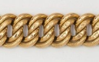 """Bracelet """" Gourmette """" in yellow gold partially braided. Ratchet clasp with safety chain. Length : 20,5cm. P. 32,5g. (dents)"""