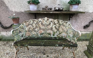Cast iron garden bench decorated with an interlacing...