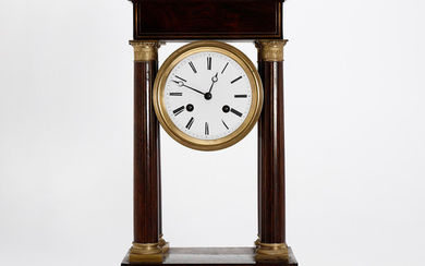 "Charles X ""portico"" table clock with case in rosewood and gilt bronze, second quarter of the 19th Century."