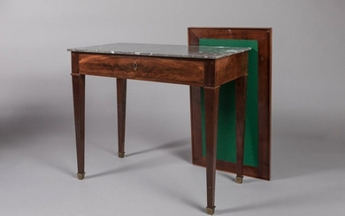 DIRECTORY MIDDLE TABLE in mahogany veneer, opening by a drawer in belt. It rests on sheathed legs. Covered with a grey Saint-Anne marble. It is surmounted by an adapted removable top. Double-sided it is darkened with a leather to make a writing table...