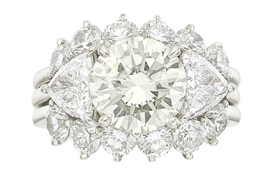 Diamond, Platinum Ring Set The ring features a round...