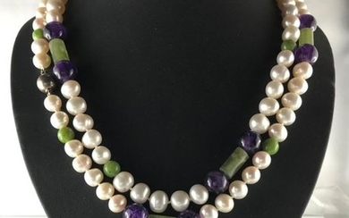 Long necklace of freshwater cultured pearls of approx....
